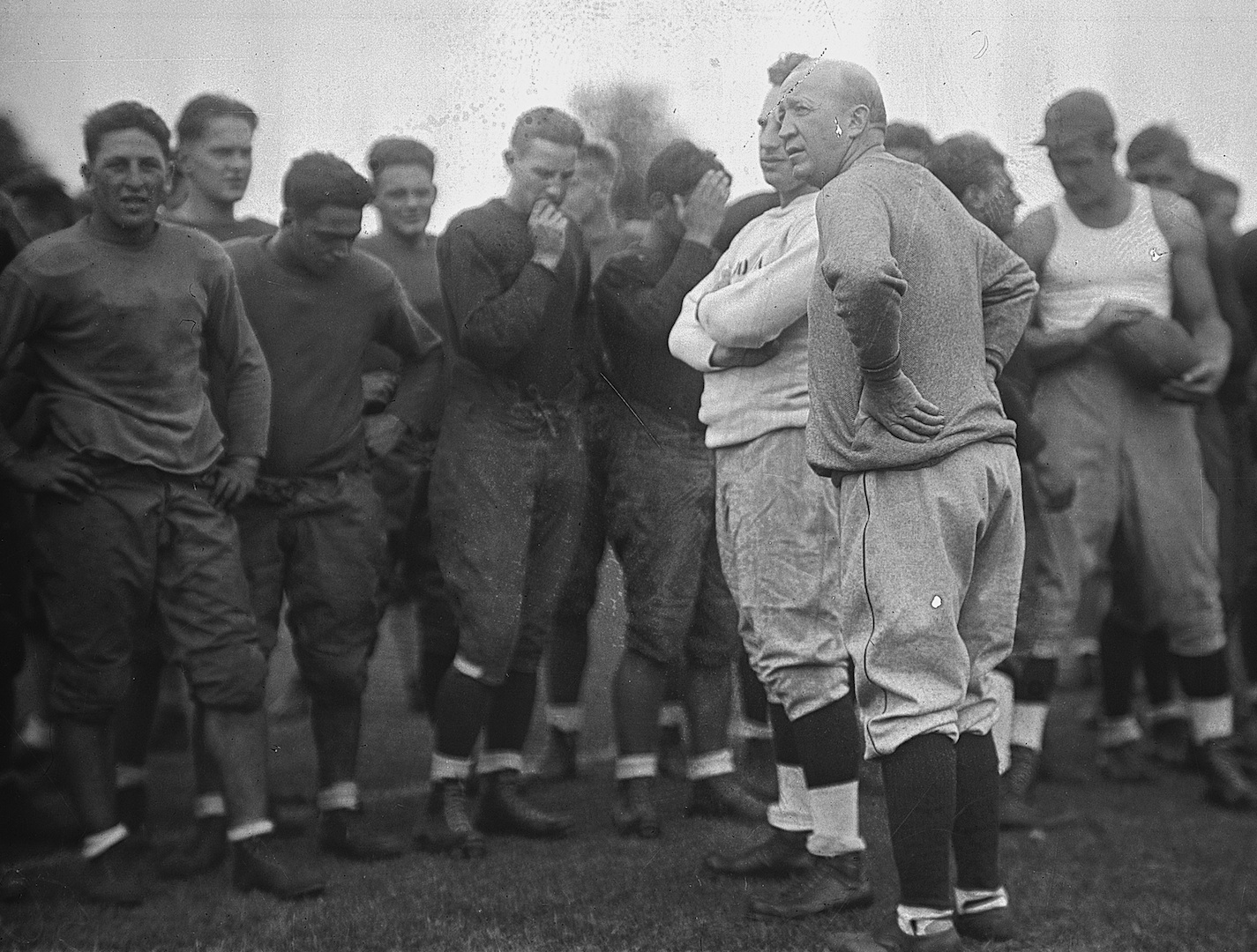 GBBY 45G/0382: Football Coach Knute Rockne at practice with players, c1920s.
