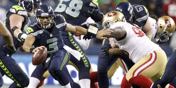 Dec 23, 2012, Seattle, WA, USA; Seattle Seahawks quarterback Russell Wilson (3) scrambles out of the pocket against the San Francisco 49ers during the third quarter at CenturyLink Field. Mandatory Credit: Joe Nicholson-USA TODAY Sports