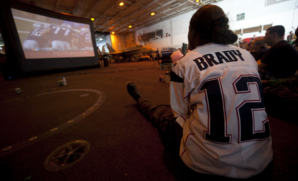120206-N-OY799-136 PACIFIC OCEAN (Feb. 06, 2012) Aviation Boatswain's Mate (Equipment) Airman Charmeta Coble watches her team play during the Super Bowl party in the hangar bay aboard the Nimitz-class aircraft carrier USS John C. Stennis (CVN 74). Sailors from both sides looked on as the Giants defeated the Patriots 21-17 in Super Bowl XLVI. John C. Stennis is operating in the U.S. 7th Fleet area of responsibility while on a seven-month deployment. (U.S. Navy photo by Mass Communication Specialist 3rd Class Kenneth Abbate/Released)
